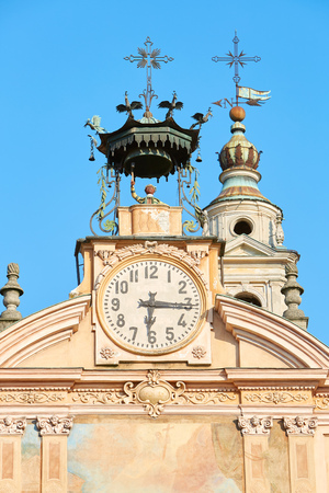 Saint Peter and Paul church clock and bell tower with automaton in a sunny summer day, blue sky in Mondovi, Italy Imagens
