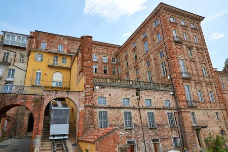 Funicular train and ancient bricks buildings in a sunny summer day in Mondovi, Italy Imagens