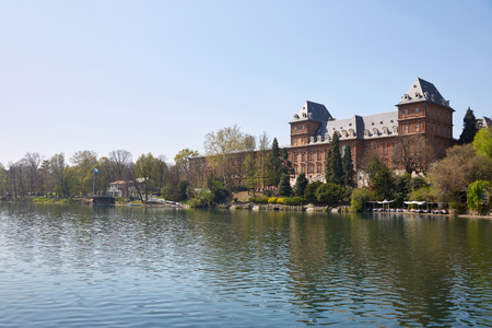 Valentino castle and Po river in a sunny spring day in Piedmont, Turin, Italy Editorial