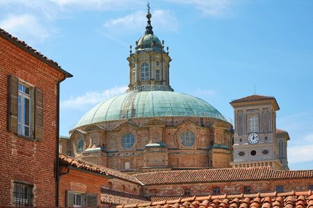 Sanctuary of Vicoforte dome and bricks buildings in a sunny summer day in Piedmont, Italy