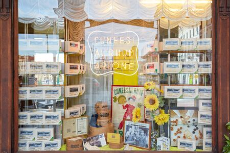 CUNEO, ITALY - AUGUST 13, 2016: Arione ancient pastry shop and cafe window in a summer day in Cuneo, Italy. Editoriali