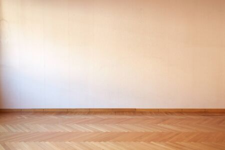 Room interior with wooden floor in empty apartment