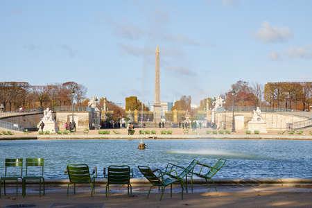 PARIS - NOVEMBER 7, 2019: Tuileries garden fountain and Place de la Concorde obelisk view, sunny autumn in Paris