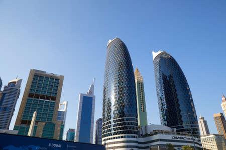 DUBAI, UNITED ARAB EMIRATES - NOVEMBER 23, 2019: Dubai financial district, modern skyscrapers in a sunny day, blue sky