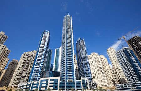 Dubai Marina new and under construction skyscrapers in a sunny day, clear blue sky in Dubai