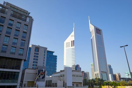 DUBAI, UNITED ARAB EMIRATES - NOVEMBER 23, 2019: Dubai financial district, modern twin skyscrapers low angle view in a sunny day, blue sky Stock fotó