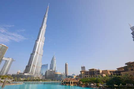DUBAI, UNITED ARAB EMIRATES - NOVEMBER 19, 2019: Burj Khalifa skyscraper, Souk al Bahar and artificial lake in a sunny day, low angle view