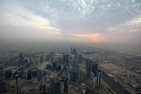 DUBAI, UNITED ARAB EMIRATES - NOVEMBER 19, 2019: Dubai city high angle view with skyscrapers at sunset seen from Burj Khalifa