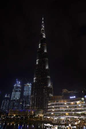 DUBAI, UNITED ARAB EMIRATES - NOVEMBER 19, 2019: Burj Khalifa skyscraper and Dubai Mall illuminated at night
