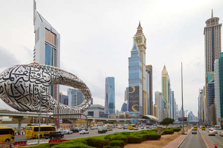 DUBAI, UNITED ARAB EMIRATES - NOVEMBER 21, 2019: Sheikh Zayed Road view with modern skyscrapers and traffic in a cloudy day