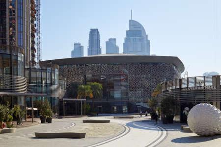 DUBAI, UNITED ARAB EMIRATES - NOVEMBER 22, 2019: Dubai Opera building and store in a sunny day