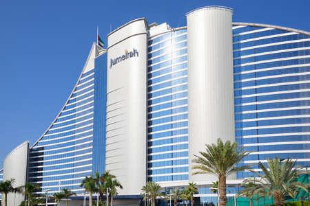 DUBAI, UNITED ARAB EMIRATES - NOVEMBER 22, 2019: Jumeirah Beach luxury hotel in a sunny day with palm trees, blue sky in Dubai