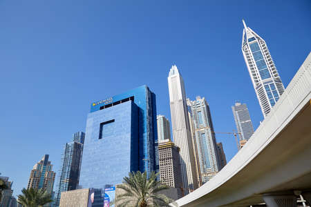 DUBAI, UNITED ARAB EMIRATES - NOVEMBER 22, 2019: Modern skyscrapers and flyover in Dubai downtown in a sunny day, clear blue sky Sajtókép