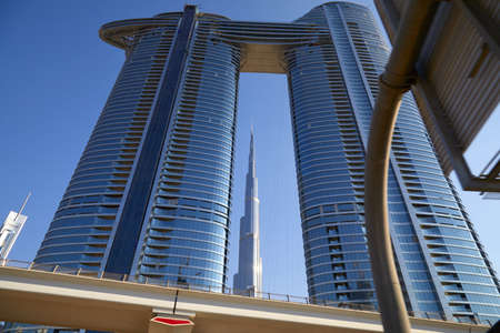 DUBAI, UNITED ARAB EMIRATES - NOVEMBER 23, 2019: Burj Khalifa skyscraper and Address Sky View towers in a clear sunny day, low angle angle view