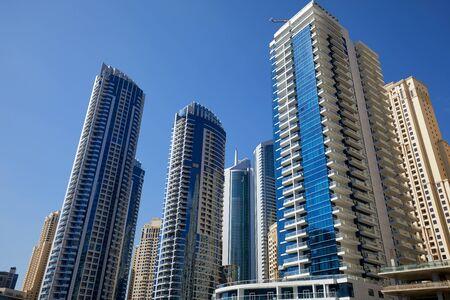 Dubai Marina skyscrapers in a sunny day, clear blue sky in Dubai Stock fotó
