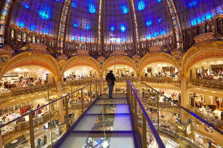 PARIS - NOVEMBER 6, 2019: Galeries Lafayette interior with Glasswalk installation with one person in Paris
