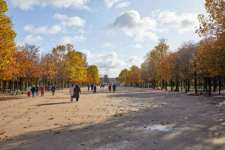 PARIS - NOVEMBER 7, 2019: Tuileries garden, walk with people in a sunny autumn day in Paris Stock fotó - 147052342