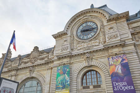 PARIS, FRANCE - NOVEMBER 8, 2019: Gare D'Orsay or Orsay museum building facade with clock in a cloudy day in Paris Stock fotó - 147052344
