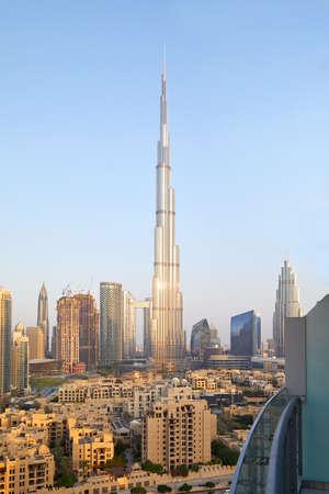 Burj Khalifa skyscraper and Dubai city view from balcony in a clear, sunny morning