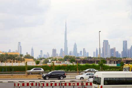 DUBAI, UNITED ARAB EMIRATES - NOVEMBER 21, 2019: Burj Khalifa skyscraper and city skyline view with cars passing