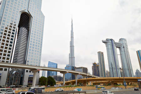 DUBAI, UNITED ARAB EMIRATES - NOVEMBER 21, 2019: Burj Khalifa skyscraper, modern buildings, flyover and streets in a cloudy day in Dubai Stock fotó - 147052349