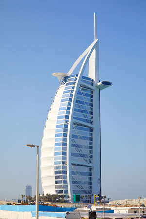 DUBAI, UNITED ARAB EMIRATES - NOVEMBER 22, 2019: Burj Al Arab luxury hotel in a sunny day, blue sky in Dubai