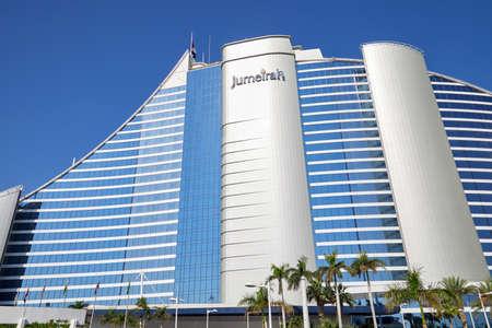 DUBAI, UNITED ARAB EMIRATES - NOVEMBER 22, 2019: Jumeirah Beach luxury hotel with palm trees in a sunny day, blue sky in Dubai