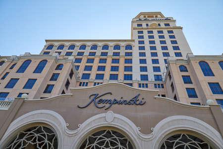DUBAI, UNITED ARAB EMIRATES - NOVEMBER 22, 2019: Kempinski, luxury hotel facade low angle view in a sunny day