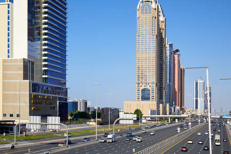 DUBAI, UNITED ARAB EMIRATES - NOVEMBER 22, 2019: Sheikh Zayed Road view with skyscrapers in a sunny day, blue sky