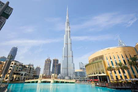 DUBAI, UNITED ARAB EMIRATES - NOVEMBER 19, 2019: Burj Khalifa skyscraper Dubai Mall and artificial lake in a sunny morning