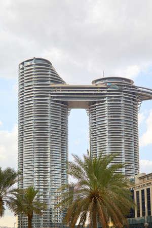 DUBAI, UNITED ARAB EMIRATES - NOVEMBER 21, 2019: Address Sky View luxury hotel with palm trees, cloudy sky in Dubai