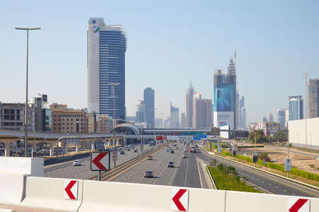 DUBAI, UNITED ARAB EMIRATES - NOVEMBER 22, 2019: Sheikh Zayed Road view with skyscrapers and traffic in a sunny day, blue sky