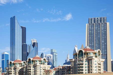 DUBAI, UNITED ARAB EMIRATES - NOVEMBER 23, 2019: Roda Al Murooj luxury hotel buildings with skyscrapers in a sunny day, blue sky