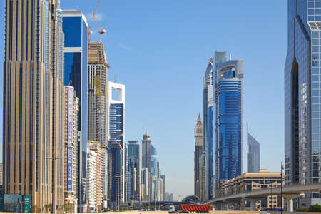 DUBAI, UNITED ARAB EMIRATES - NOVEMBER 23, 2019: Sheikh Zayed Road view with modern skyscrapers in a sunny day, blue sky