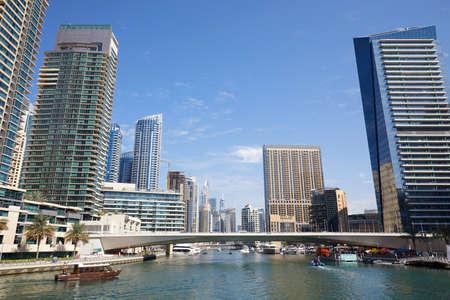 DUBAI, UNITED ARAB EMIRATES - NOVEMBER 23, 2019: Dubai Marina skyscrapers and canal with boats in a sunny day, clear blue sky in Dubai Sajtókép