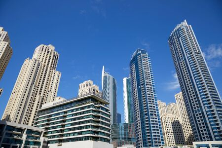 Dubai Marina skyscrapers, low angle view in a sunny day, clear blue sky in Dubai Stock fotó - 147350247