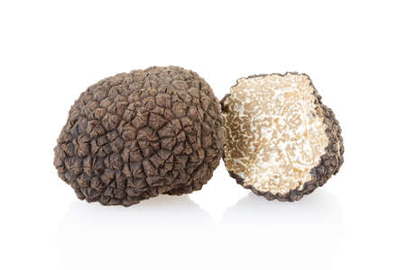 Black truffle and section isolated on white Stock fotó