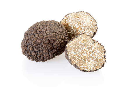 Black truffle and slices isolated on white, clipping path included