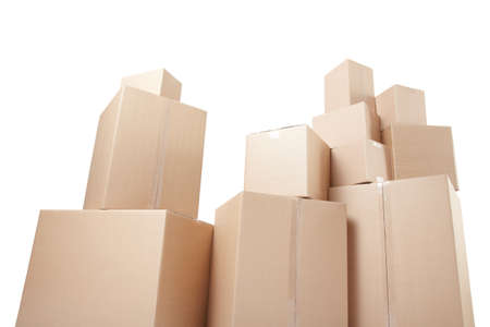 Cardboard boxes stack, low angle view isolated on white