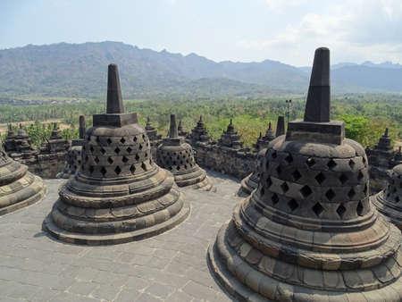 stupas: Borobudur stupas overlooking a forest