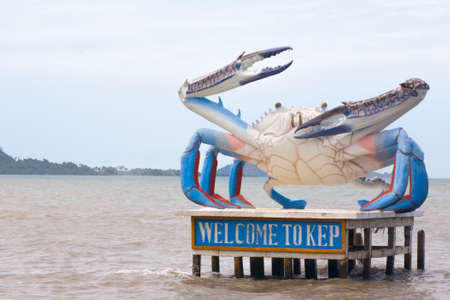 Welcome to Kep Crab statue in Cambodia Sea Coast with blue claw chela Stock Photo