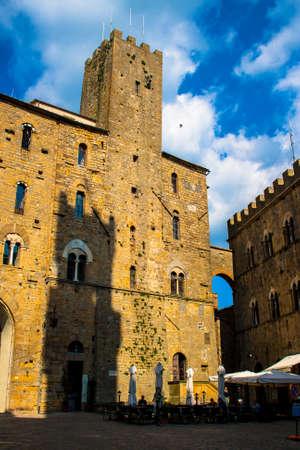priori: a view with a shadow of palazzo priori in Volterra