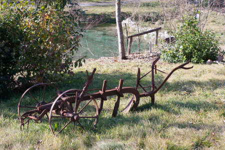 plow: old plow in a garden