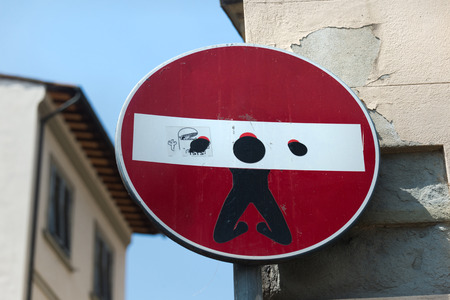 beheaded: Florence, Italy - August 5, 2014 - Street art by Clet Abraham