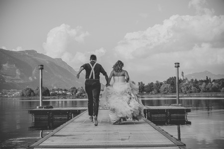 trash the dress: bride and groom on the water in the lake at sunseet, trash the dress