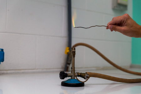 powder test a Bunsen burner showing flame and hose. photo
