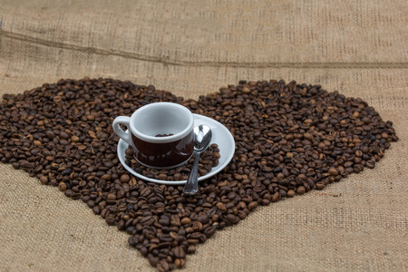 love pic: Coffee beans on brown jute background
