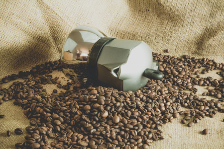 coffee pot: coffee pot on coffee beans Stock Photo