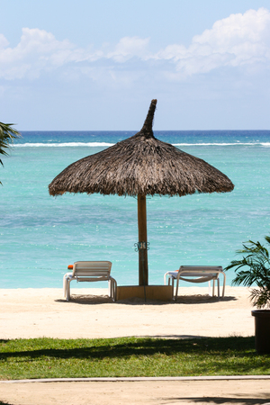 idling: Beach Chairs and Umbrella on a beautiful island, panoramic view