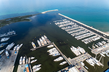 Aerial view on a port with yachts and motor boats